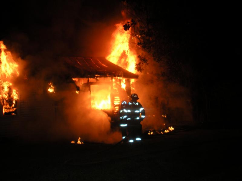 Two Lafayette Firefighters work the front of the structure